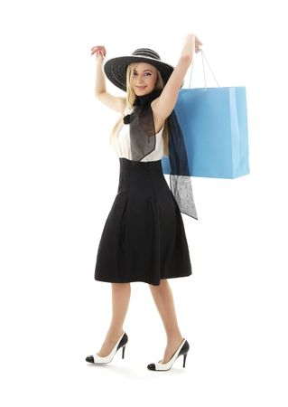 mania: elegant blond in retro hat with blue shopping bag
