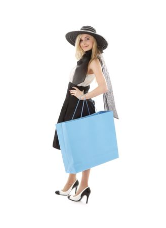 elegant blond in retro hat with blue shopping bag photo