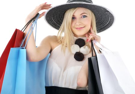 elegant blond in retro hat with shopping bags photo