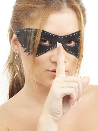portrait of beautiful young woman in black mask photo