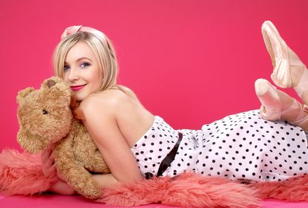 pink teddy bear: picture of lovely blond with teddy bear over pink Stock Photo