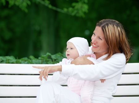 outdoor picture of happy mother with baby (focus on faces) photo