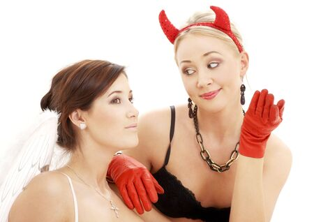 devil: picture of angel and devil woman over white