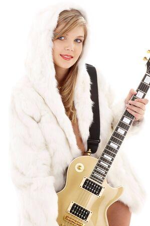 golden guitar girl in fur over white Stock Photo - 2478902