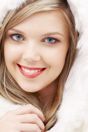 closeup portrait of lovely blond in fur photo