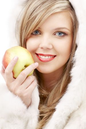closeup portrait of lovely blond in fur with apple Stock Photo - 2494848