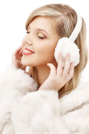 picture of smiling blond in furry headphones Stock Photo - 2517085