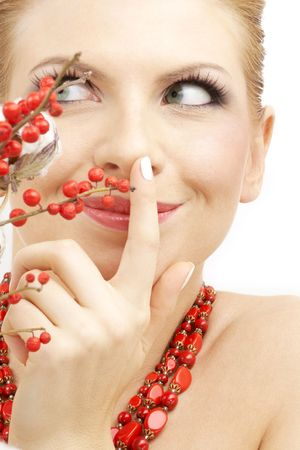 portrait of lovely blond with red ashberry and cotton photo