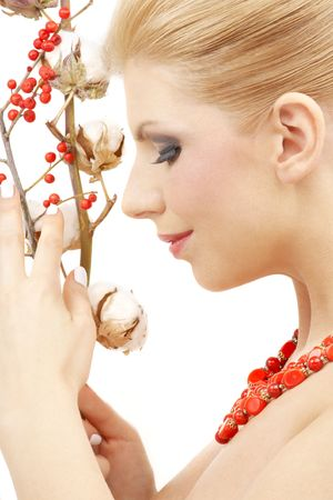 portrait of lovely blond with red ashberry and cotton Stock Photo - 2504263
