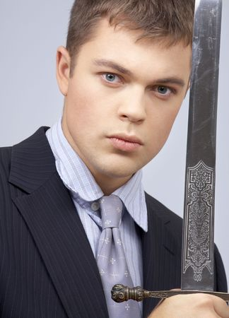 portrait of aggressive corporate worker with sword photo