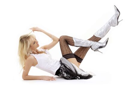 classical pin-up image of laying blonde in silver boots Stock Photo - 2574514