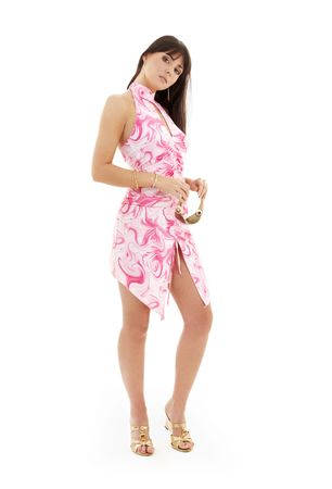lovely girl in pink dress and golden platform shoes over white