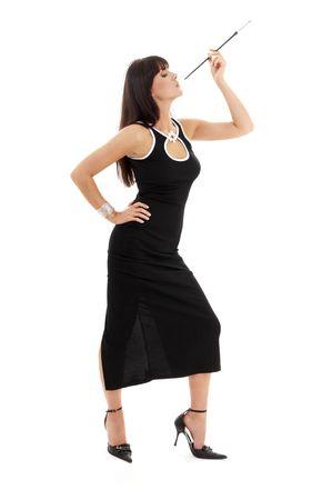 brunette in black dress with cigarette holder over white Stock Photo