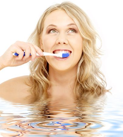 picture of happy blond with toothbrush in water photo