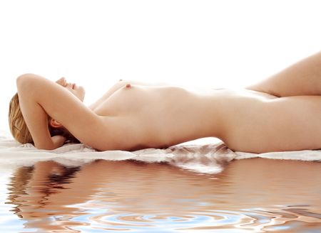 aqua naked: classical picture of healthy naked woman on white sand Stock Photo