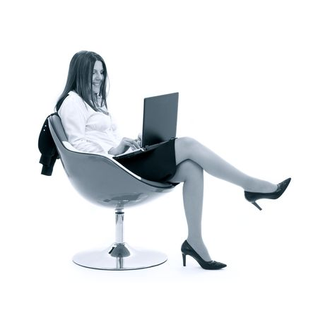 monochrome businesswoman with laptop in chair over white photo