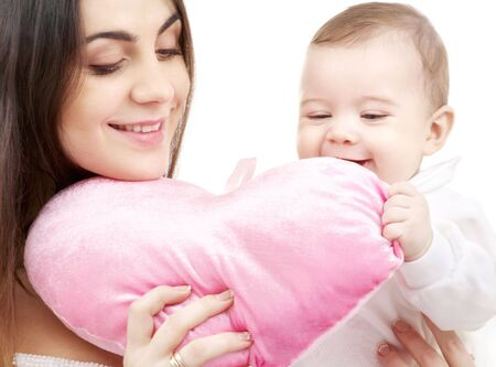 happy baby and mama with heart-shaped pillow Stock Photo - 2602333