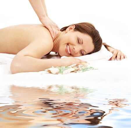 picture of lovely lady taking massage on white sand Stock Photo - 2615885