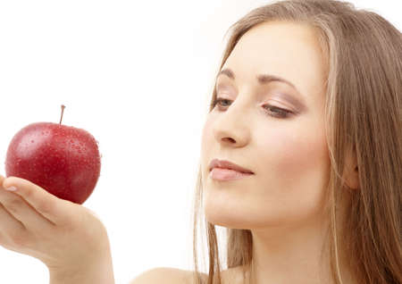 portrait of woman with apple over white Stock Photo - 2643968