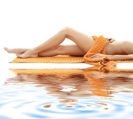 long legs of relaxed lady with orange towel on white sand Stock Photo - 2643967