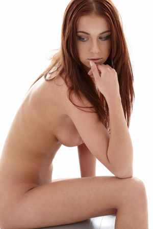 classical artistic nudity picture of sitting naked girl photo