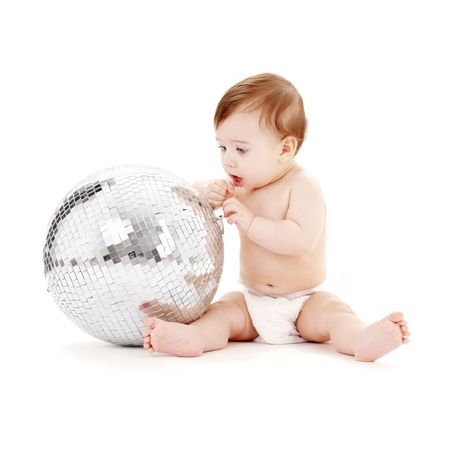 adorable baby boy with big glitterball  over white Stock Photo - 2691265