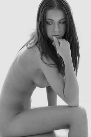 monochrome artistic nudity picture of sitting naked girl photo