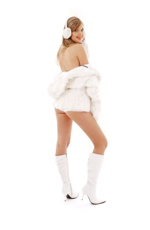 lovely blonde in boots, fur and headphones Stock Photo - 2726615