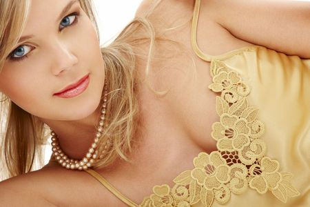 demure: portrait of mysterious blue-eyed blond in pearls