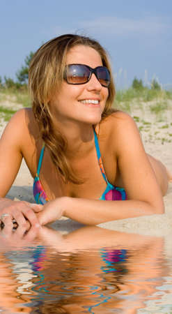 picture of pretty woman relaxing on the beach photo