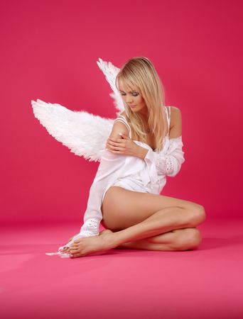 picture of lonely angel girl over pink Stock Photo - 2785141