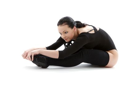 lovely girl in black leotard working out over white Stock Photo - 2817932