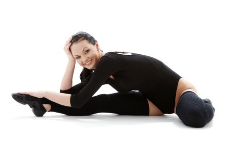 legwarmers: lovely girl in black leotard working out over white