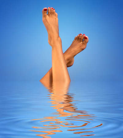 picture of female legs  in blue water Stock Photo - 2838907