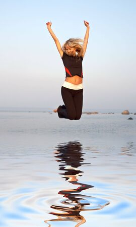 fit girl jumping at the seashore Stock Photo - 2874069