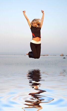 fit girl jumping at the seashore Stock Photo - 2874069