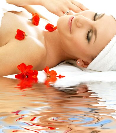 beautiful lady with red flowers in spa Stock Photo - 2886047