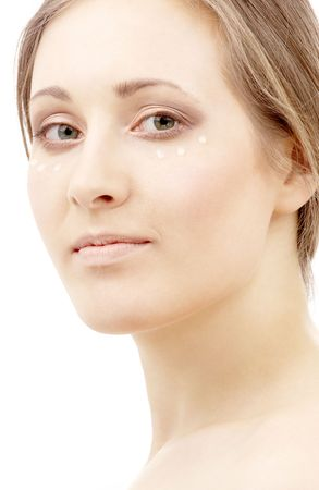 rejuvenating: beautiful woman with moisturizing milk drops on face