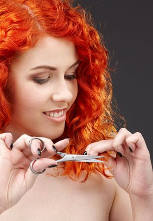 picture of lovely redhead with scissors over grey Stock Photo - 3083783
