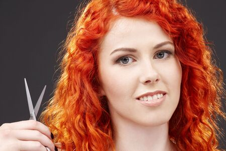 picture of lovely redhead with scissors over grey Stock Photo - 3083784