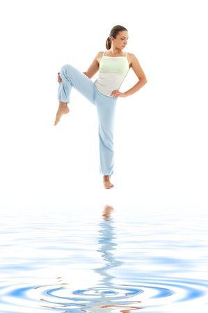 ashtanga: lovely girl practicing ashtanga yoga on white sand