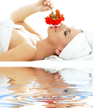 lovely woman in spa smelling red flower Stock Photo - 22419886