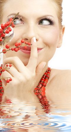 lovely blonde with red ashberry and cotton in water  Stock Photo - 3084024