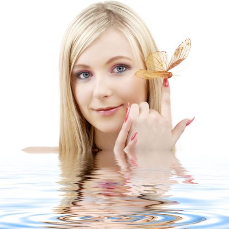 picture of lovely blond with butterfly in water Stock Photo