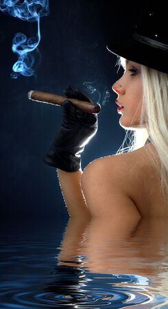 backlight image of topless girl smoking cigar in water Stock Photo - 3084042