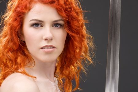 face guard: lovely redhead with medieval sword over grey