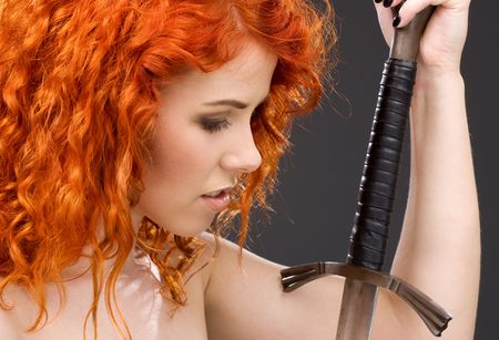 lovely redhead with medieval sword over grey Stock Photo - 3199770