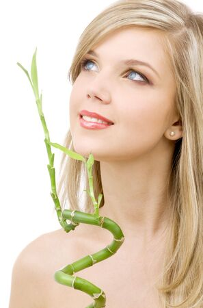 graft: picture of lovely blue-eyed blonde with bamboo LANG_EVOIMAGES