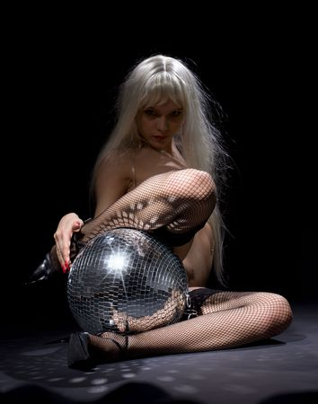 party dancer girl in fishnet stockings with disco ball (focus on ball) Stock Photo - 3199777