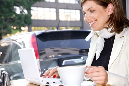happy businesswoman drinking morning coffee and surfing internet Stock Photo - 3199826
